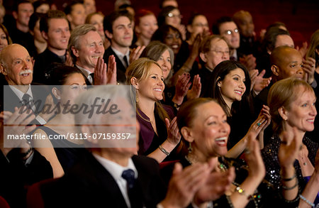 Clapping theater audience Stock Photo - Premium Royalty-Free, Image code: 6113-07159357