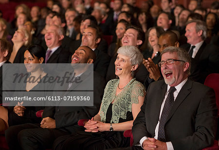 Laughing theater audience Stock Photo - Premium Royalty-Free, Image code: 6113-07159360