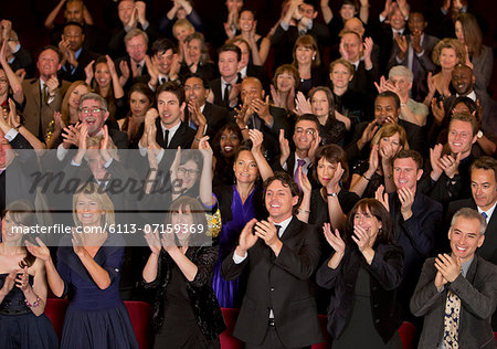 Clapping theater audience Stock Photo - Premium Royalty-Free, Image code: 6113-07159369