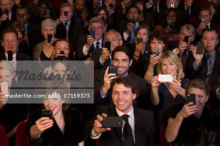 Theater audience videoing performance with smart phones Stock Photo - Premium Royalty-Free, Image code: 6113-07159373