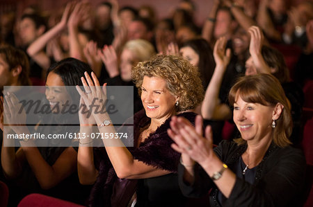 Clapping theater audience Stock Photo - Premium Royalty-Free, Image code: 6113-07159374