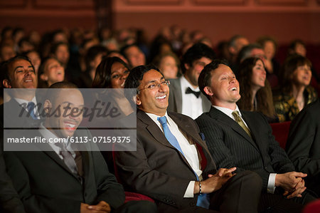 Laughing theater audience Stock Photo - Premium Royalty-Free, Image code: 6113-07159375