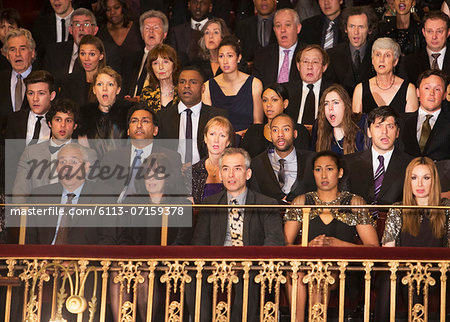 Serious audience in theater balcony Stock Photo - Premium Royalty-Free, Image code: 6113-07159378