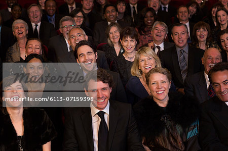 Smiling theater audience Stock Photo - Premium Royalty-Free, Image code: 6113-07159398
