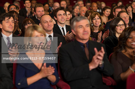 Clapping theater audience Stock Photo - Premium Royalty-Free, Image code: 6113-07159407
