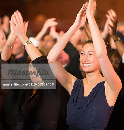Enthusiastic women clapping in theater audience Stock Photo - Premium Royalty-Free, Image code: 6113-07159408