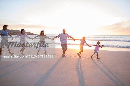 Family holding hands on beach Stock Photo - Premium Royalty-Free, Image code: 6113-07159488