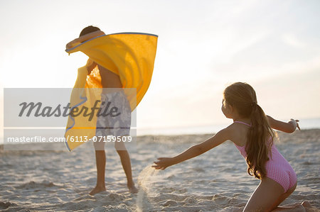 Children playing on beach Stock Photo - Premium Royalty-Free, Image code: 6113-07159509