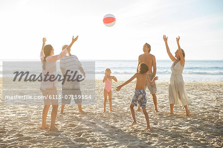 Family playing together on beach Stock Photo - Premium Royalty-Free, Image code: 6113-07159554