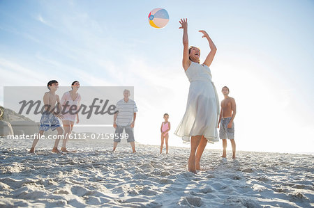 Family playing together on beach Stock Photo - Premium Royalty-Free, Image code: 6113-07159559