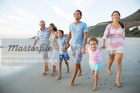 Family walking together on beach Stock Photo - Premium Royalty-Free, Image code: 6113-07159579