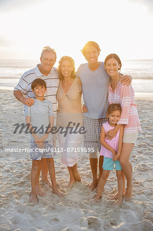 Family smiling together on beach Stock Photo - Premium Royalty-Free, Image code: 6113-07159595