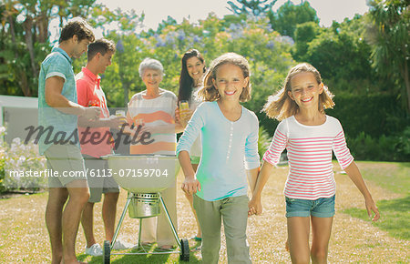 Family relaxing together in backyard Stock Photo - Premium Royalty-Free, Image code: 6113-07159704