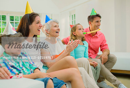 Family celebrating birthday together Stock Photo - Premium Royalty-Free, Image code: 6113-07159707