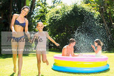 Family playing together in backyard Stock Photo - Premium Royalty-Free, Image code: 6113-07159718