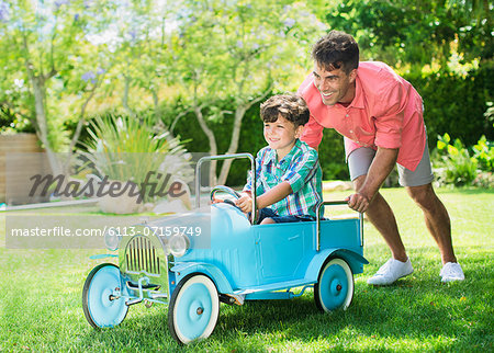 Father and son playing in backyard Stock Photo - Premium Royalty-Free, Image code: 6113-07159749