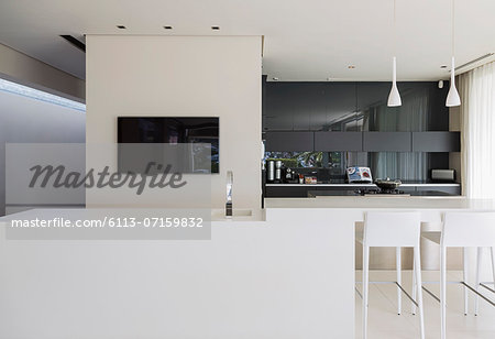 Sink and breakfast bar in modern kitchen Stock Photo - Premium Royalty-Free, Image code: 6113-07159832