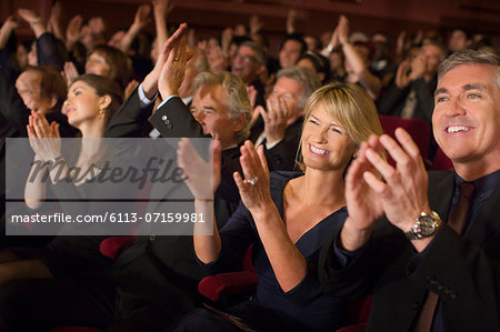 Enthusiastic audience clapping in theater Stock Photo - Premium Royalty-Free, Image code: 6113-07159981
