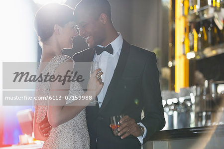 Well dressed couple hugging in luxury bar Stock Photo - Premium Royalty-Free, Image code: 6113-07159988