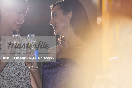 Well dressed women drinking champagne in luxury bar Stock Photo - Premium Royalty-Free, Image code: 6113-07159990