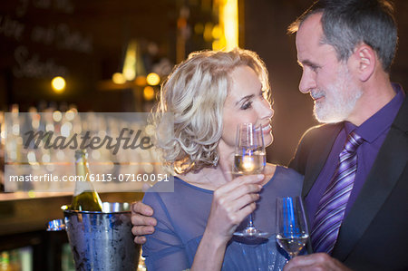 Close up of well dressed couple drinking champagne Stock Photo - Premium Royalty-Free, Image code: 6113-07160051