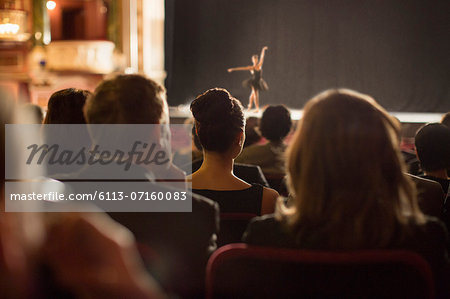 Rear view of theater audience watching performers on stage Stock Photo - Premium Royalty-Free, Image code: 6113-07160083
