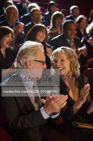 Clapping theater audience Stock Photo - Premium Royalty-Free, Image code: 6113-07160093