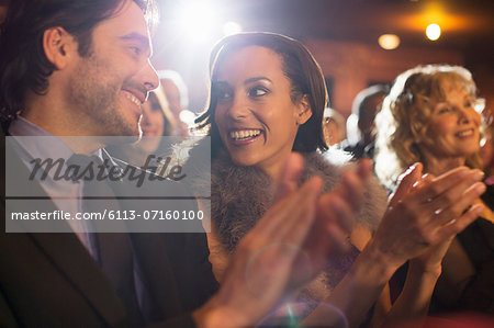 Close up of couple clapping in theater Stock Photo - Premium Royalty-Free, Image code: 6113-07160100