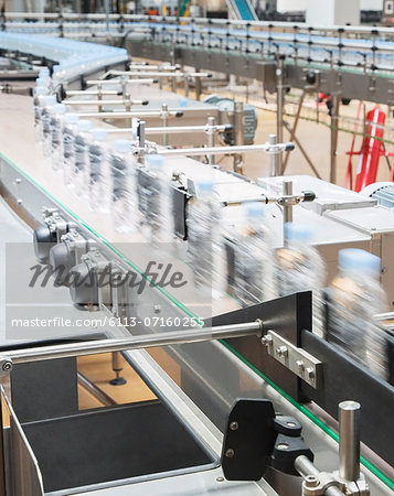 Bottles on conveyor belt in factory Stock Photo - Premium Royalty-Free, Image code: 6113-07160255