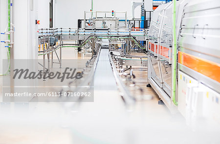 Conveyor belt in factory Stock Photo - Premium Royalty-Free, Image code: 6113-07160262
