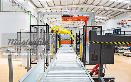 Conveyor belt in factory Stock Photo - Premium Royalty-Free, Image code: 6113-07160302