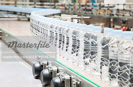 Bottles on conveyor belt in factory Stock Photo - Premium Royalty-Free, Image code: 6113-07160313