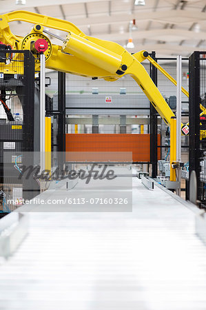 Robotic machinery in factory Stock Photo - Premium Royalty-Free, Image code: 6113-07160326