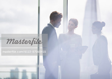 Business people talking in office Stock Photo - Premium Royalty-Free, Image code: 6113-07160415