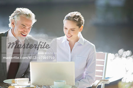 Business people working at sidewalk cafe Stock Photo - Premium Royalty-Free, Image code: 6113-07160710