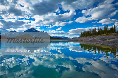 Clouds reflected in still lake Stock Photo - Premium Royalty-Free, Image code: 6113-07160747