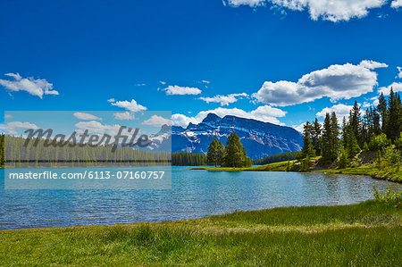 Snowy mountains overlooking lake Stock Photo - Premium Royalty-Free, Image code: 6113-07160757