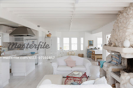 White kitchen and living room Stock Photo - Premium Royalty-Free, Image code: 6113-07160857