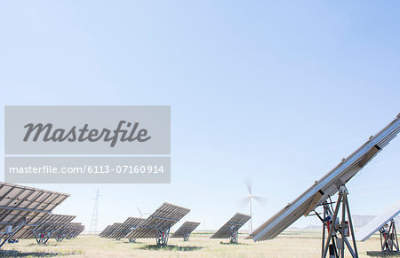 Solar panels in rural landscape Stock Photo - Premium Royalty-Free, Image code: 6113-07160914