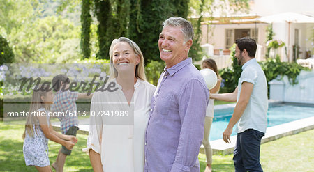 Senior couple in backyard with family