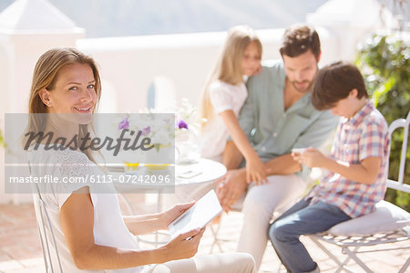 Family relaxing on patio Stock Photo - Premium Royalty-Free, Image code: 6113-07242096