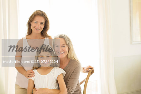 Multi-generation women smiling at window Stock Photo - Premium Royalty-Free, Image code: 6113-07242104