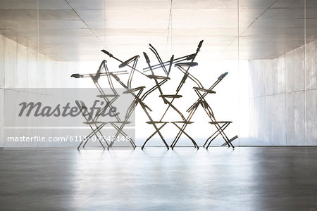 Silhouette of office chair installation art Stock Photo - Premium Royalty-Free, Image code: 6113-07242148