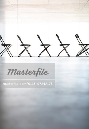 Chairs lined up in a row in office Stock Photo - Premium Royalty-Free, Image code: 6113-07242175