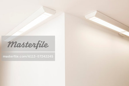 Ceiling lights in corner of office Stock Photo - Premium Royalty-Free, Image code: 6113-07242245