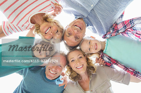 Family smiling together outdoors Stock Photo - Premium Royalty-Free, Image code: 6113-07242326