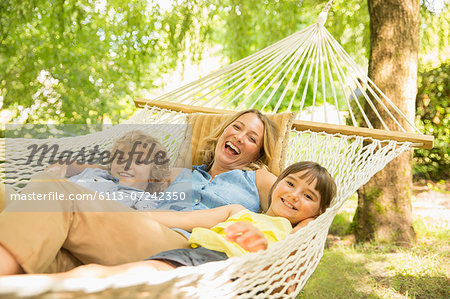 Mother and children relaxing in hammock Stock Photo - Premium Royalty-Free, Image code: 6113-07242350