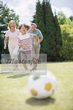 Grandparents and grandson playing soccer Stock Photo - Premium Royalty-Free, Image code: 6113-07242439