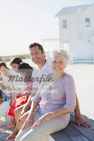 Multi-generation family smiling outside beach house Stock Photo - Premium Royalty-Free, Image code: 6113-07242512