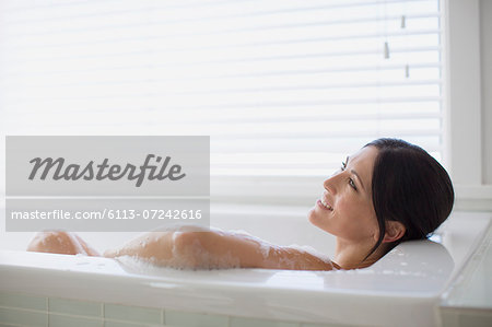 Woman relaxing in bubble bath Stock Photo - Premium Royalty-Free, Image code: 6113-07242616